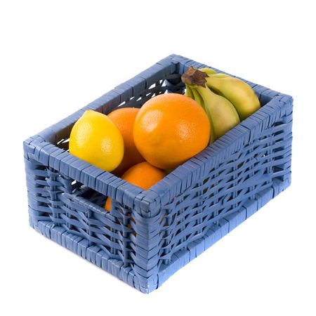 blue basket with fruits on white background photo