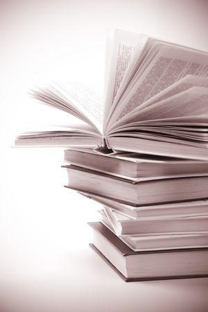 classics: stack of books closeup. monochrome image Stock Photo