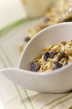 bowl of muesli on linen napkin - healthy breakfast photo
