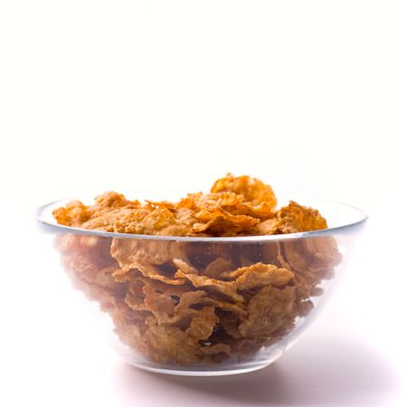 glass bowl full of cornflakes on white photo