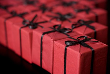 many red gift boxes on black background Stock Photo - 4350613
