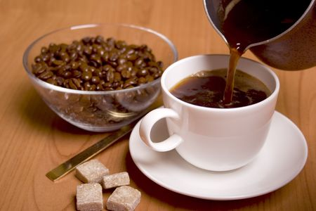 cup of coffee, sugar and beans in glass bowl on wooden table Stock Photo - 4350621