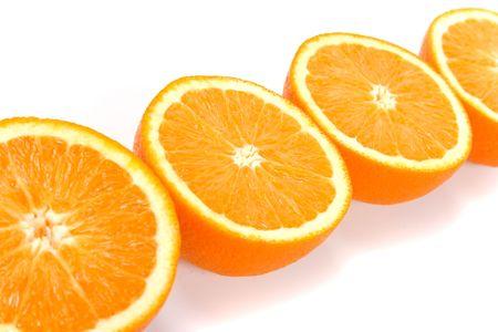 fresh oranges halves closeup on white photo