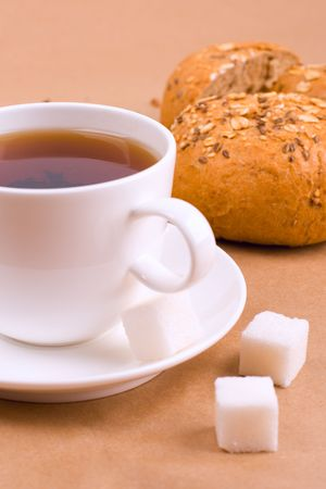 cup of tea, sugar and bread photo