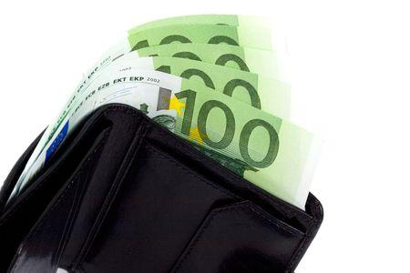 euro and a leather purse closeup on white photo