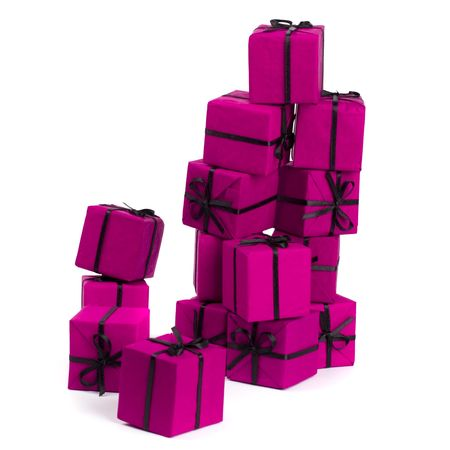 stack of pink gift boxes on white background photo