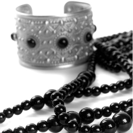 bracelet and black necklace closeup on a white background Stock Photo - 4362871