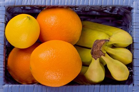 blue basket with fruits closup photo