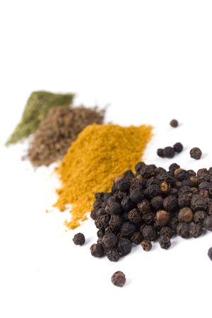 haps of various ground spices on white background   photo