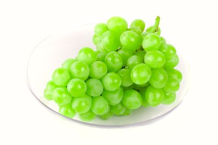 green grapes in bowl on white background photo