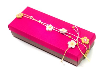 pink gift box with decoration on white background photo