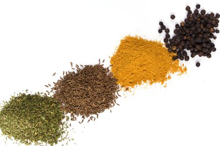 haps of various spices on white background photo