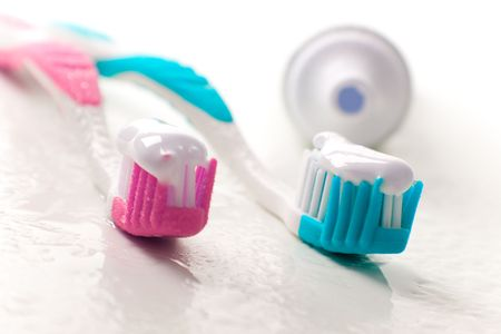 toothpaste and toothbrushes closeup. dental care photo