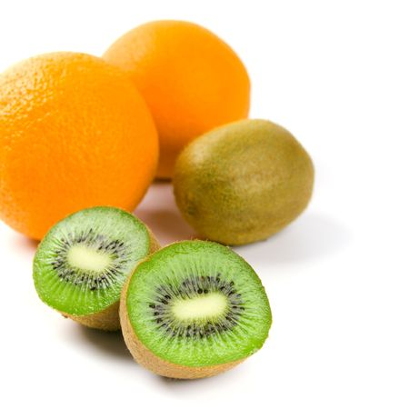 oranges and kiwi on white background photo