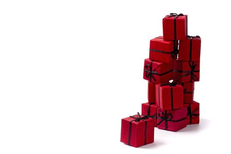 stack of red gift boxes on white background photo