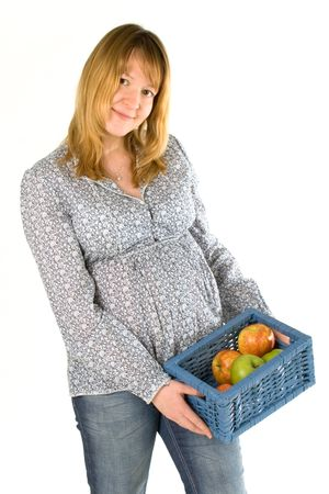 young pregnant woman with a basket full of apples Stock Photo - 4390517