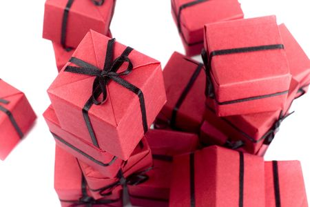 red gift boxes closeup on white background photo