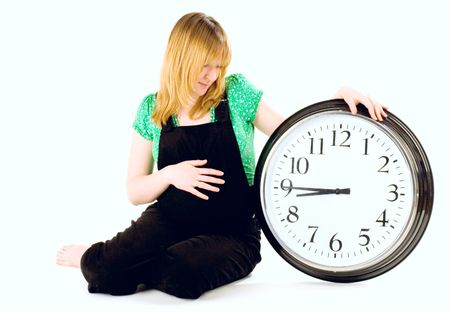 pregnant woman with a clock on white background Stock Photo - 4390516