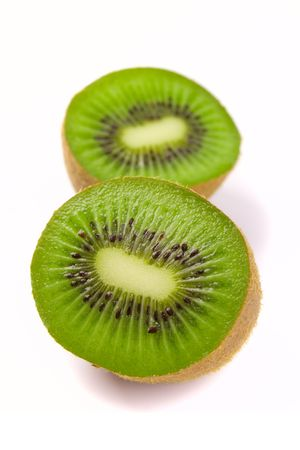 kiwi halves on white background photo