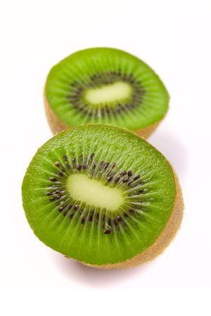 kiwi halves on white background Stock Photo - 4391000