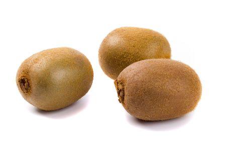 three kiwi fruit isolated on white background photo