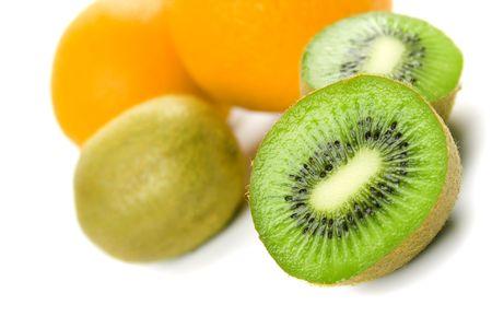 oranges and kiwi on white background photo