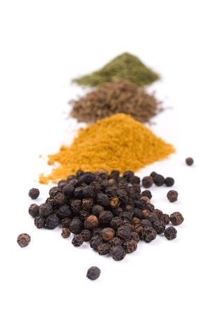 heapes of various spices on white background photo
