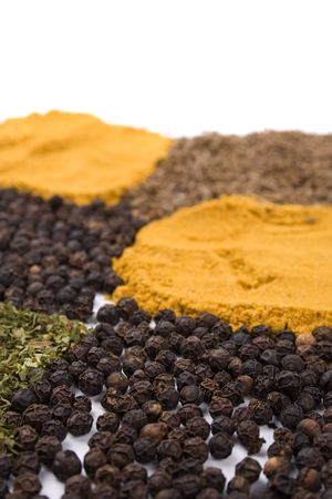 heapes of various spices closeup photo