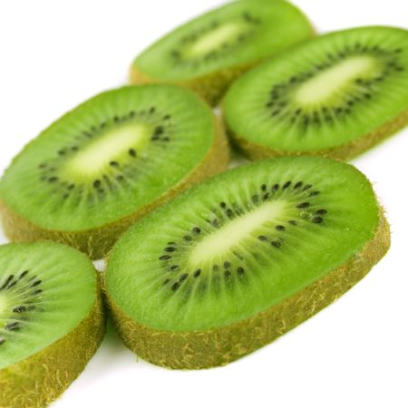 green kiwi slices closeup on white photo