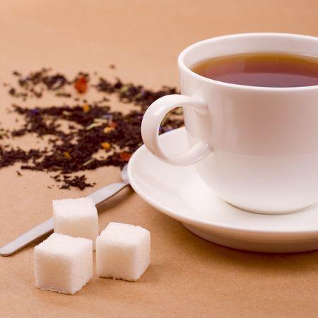 cup of tea and some sugar closeup photo