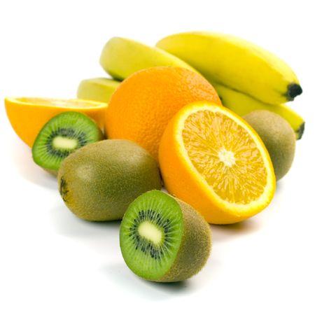 kiwi, oranges and bananas sloseup on white photo
