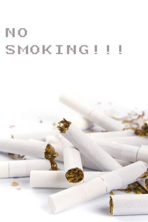 broken cigarettes closeup on white background Stock Photo - 4456534