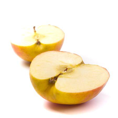 apple halves on white background photo