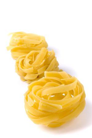 italian pasta tagliatelle on white background photo