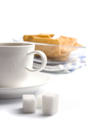cup of tea, sugar and cookies closeup on white photo