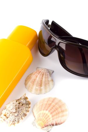 sunglasses and lotion closeup on white background Stock Photo - 4502910