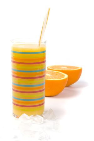 oranges, ice and juice in glass on white photo