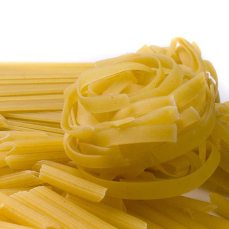 various shapes of pasta on white background photo