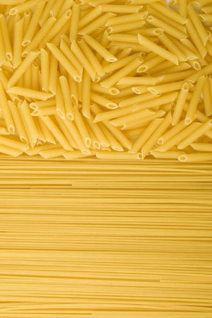 two kinds of uncooked pasta background photo