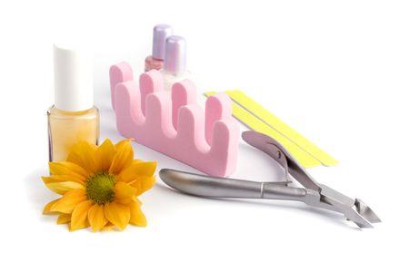 pedicure beauty set and flower cliseup photo