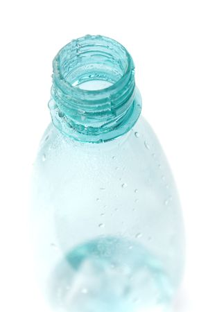 bottle with water drops closeup on white background photo