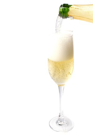 champagne being poured into glass isolated on white background. photo
