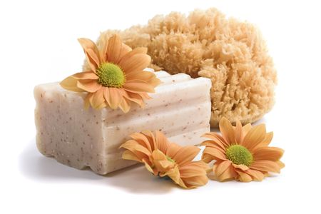 natural sponge, soap and flowers on white background Stock Photo - 4616539