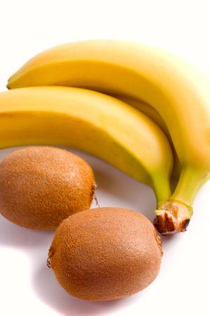 some fresh kiwi and banana closeup on white background photo