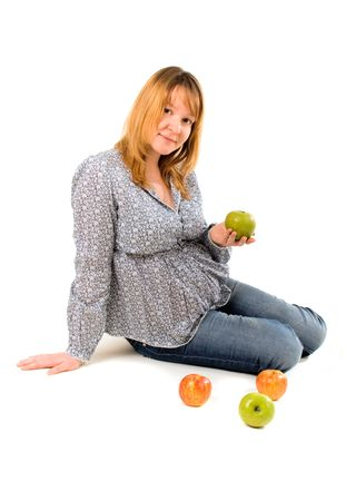 young pregnant woman with apples on white photo
