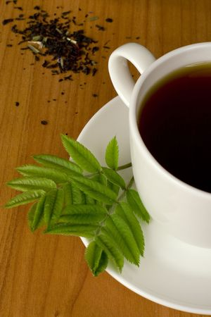 cup of black tea with herbs Stock Photo - 4780990