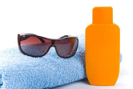 towel, sunglasses and lotion closeup on white background Stock Photo - 4780999