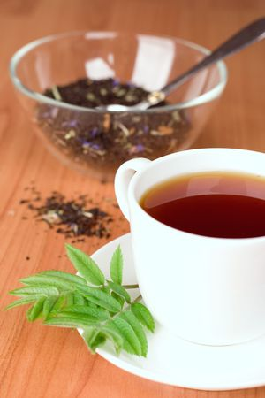 cup of black tea with herbs photo