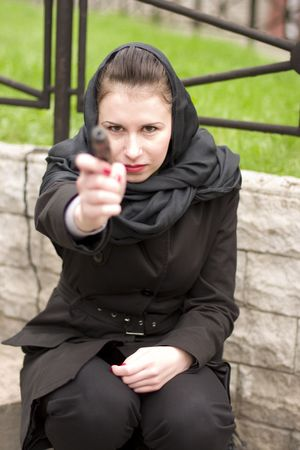 outdoor portrait of a woman with gun photo