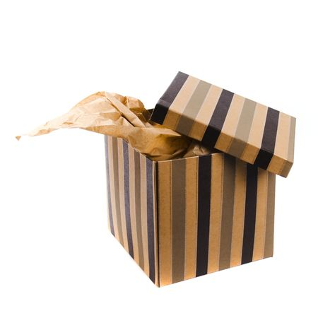 isolated opened gift box with craft paper inside photo